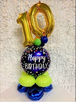 """Picture of 1 JUNIOR AGED MARQUEE - 2 FOIL 16"""" NUMBERS - ON 18"""" FOIL SITTING ON  2 LEVEL QUAD BASE"""